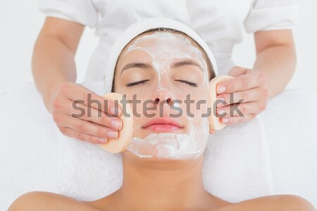Closeup of a good looking red-haired woman receiving a massage in a spa centre Stock photo © wavebreak_media