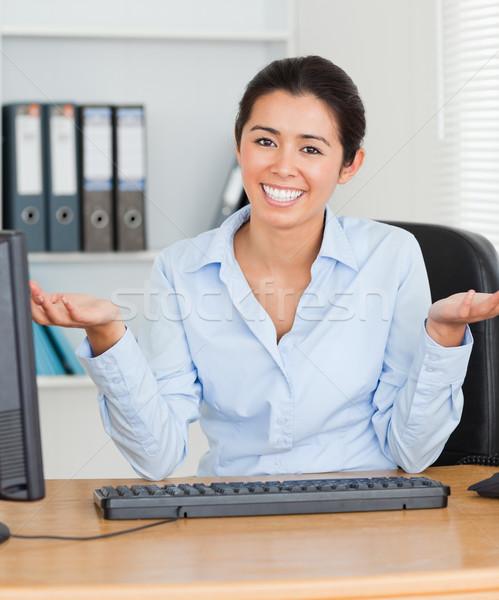 Büszke vonzó nő pózol ül iroda boldog Stock fotó © wavebreak_media