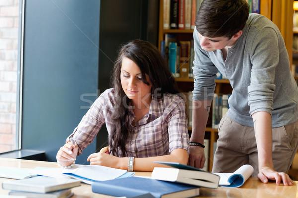 Osztálytársak segít egyéb könyvtár iskola boldog Stock fotó © wavebreak_media