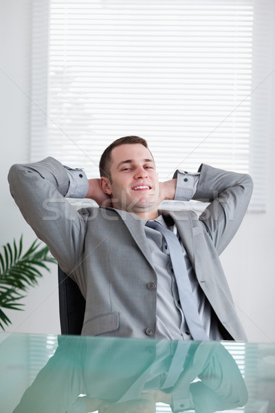 Close up of young businessman relaxing sitting behind a table Stock photo © wavebreak_media