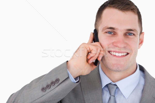 Close up of businessman on the mobile phone looking up on white background Stock photo © wavebreak_media