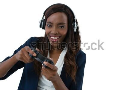 счастливым улыбающаяся женщина пения белый микрофона рот Сток-фото © wavebreak_media
