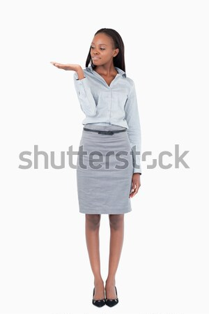 Portrait of a businesswoman displaying something against a white background Stock photo © wavebreak_media
