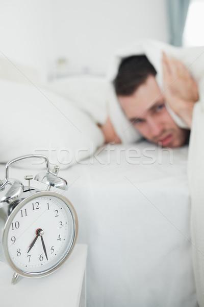 портрет красивый мужчина ушки будильник спальня стороны Сток-фото © wavebreak_media