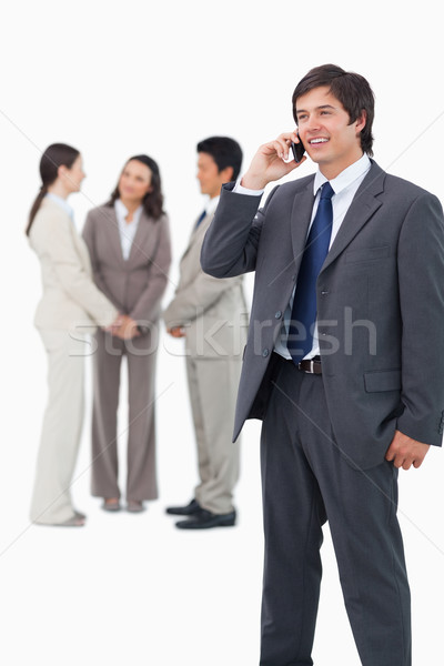Glimlachend mobieltje team achter witte Stockfoto © wavebreak_media