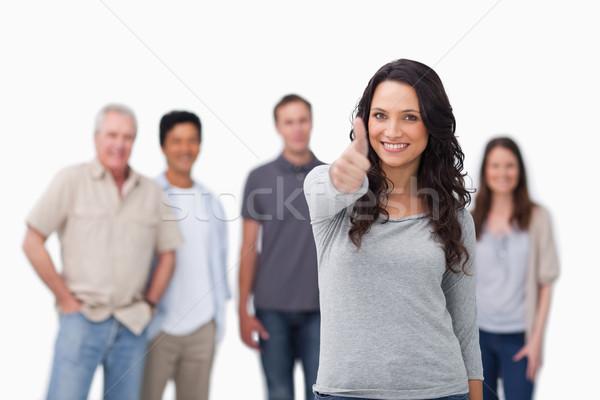 Glimlachende vrouw vrienden achter duim omhoog witte Stockfoto © wavebreak_media