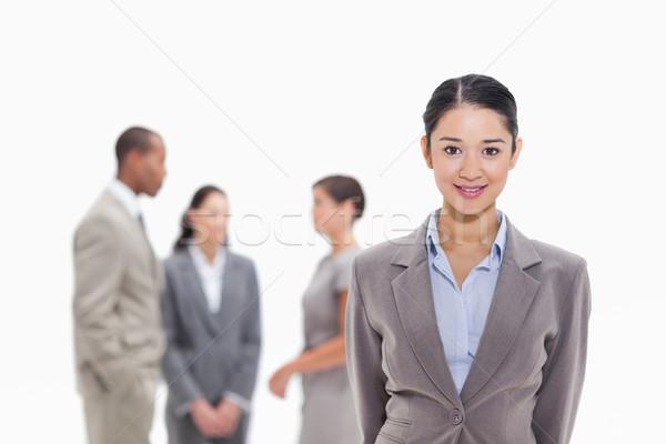 Femeie de afaceri zâmbitor vorbesc afaceri Imagine de stoc © wavebreak_media