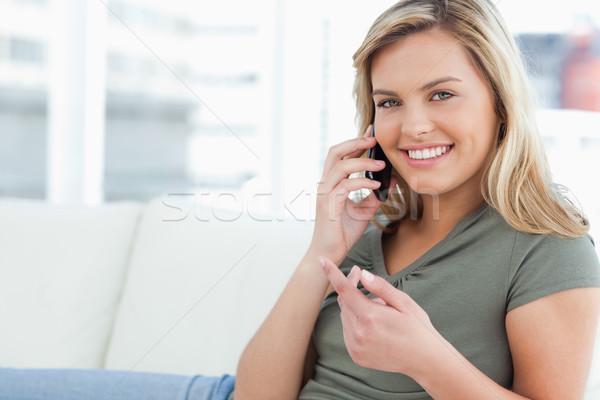 Mulher sofá mão chamar Foto stock © wavebreak_media