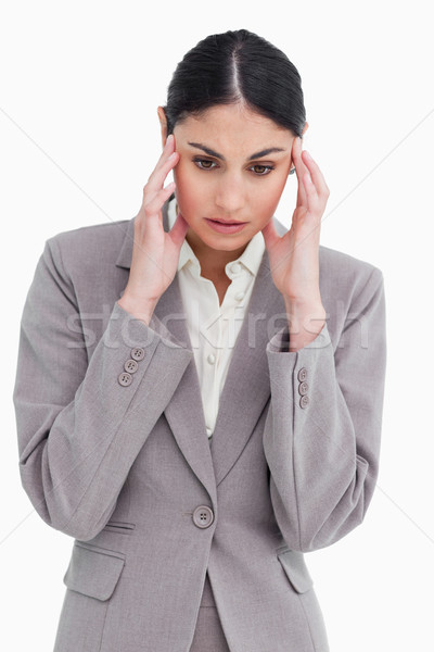 Young saleswoman experiencing a headache against a white background Stock photo © wavebreak_media