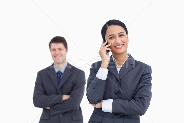 Verkoopster telefoon collega achter witte Stockfoto © wavebreak_media