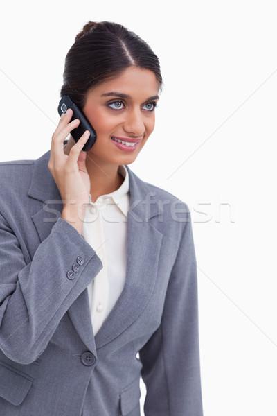 Smiling female entrepreneur on her mobile phone against a white background Stock photo © wavebreak_media