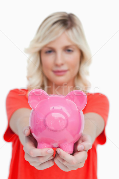 Pink piggy bank held by a teenage girl against a white background Stock photo © wavebreak_media