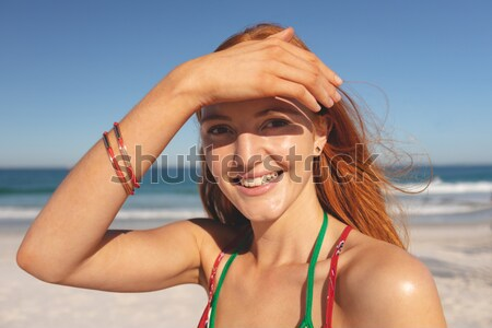 Young woman raising her arms as an indication of happiness in front of the sea Stock photo © wavebreak_media