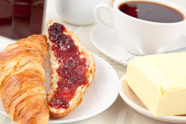 Breakfast with a croissant spread with jam indoors Stock photo © wavebreak_media