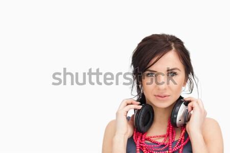 Mooie student hoofdtelefoon rond nek witte Stockfoto © wavebreak_media
