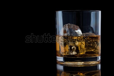 Glass with whiskey against a black background Stock photo © wavebreak_media