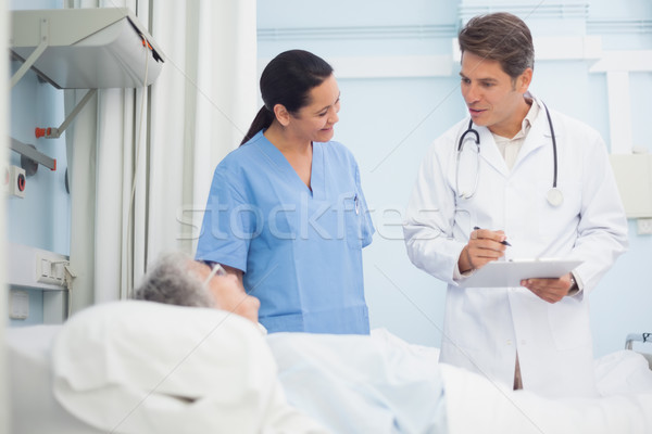 Doctor and nurse talking to a patient in hospital ward Stock photo © wavebreak_media