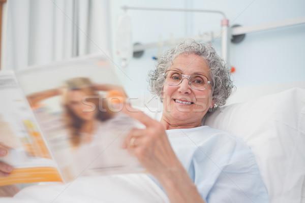 Elderly patient reading a magazine in hospital ward Stock photo © wavebreak_media