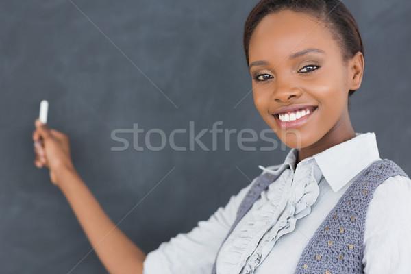 Fekete tanár néz kamera tart kréta Stock fotó © wavebreak_media