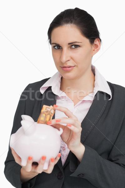 Brunette geld spaarpot witte gelukkig pak Stockfoto © wavebreak_media