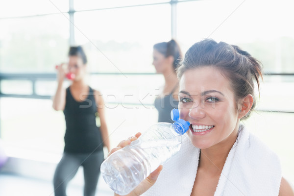 Stock photo: Women talking while another drinking water in fitness studio in gym
