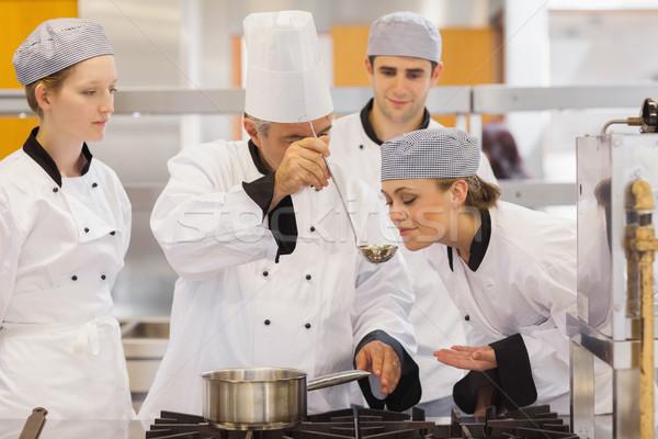 Student tasting the teacher's soup in culinary school Stock photo © wavebreak_media
