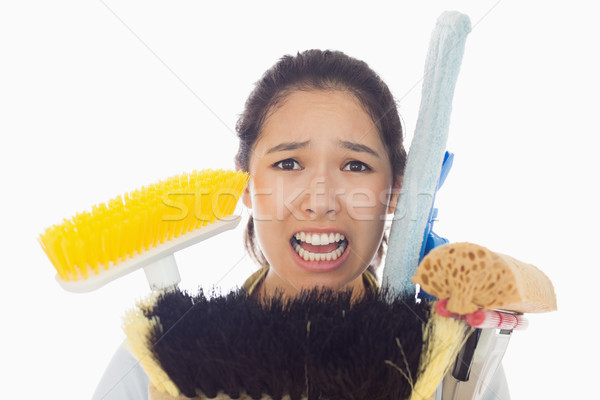 Very stressed young woman with cleaning tools Stock photo © wavebreak_media