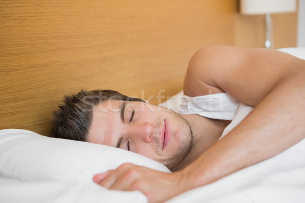 Man asleep in hotel room Stock photo © wavebreak_media