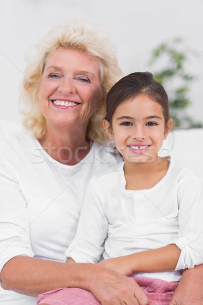 Boldog leányunoka nagymama portré ül kanapé Stock fotó © wavebreak_media