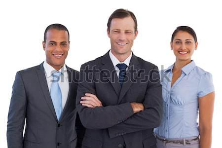 Mała grupa uśmiechnięty ludzi biznesu stałego wraz biały Zdjęcia stock © wavebreak_media