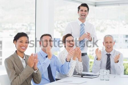 Csoport üzletemberek tapsol együtt tárgyalóterem nő Stock fotó © wavebreak_media