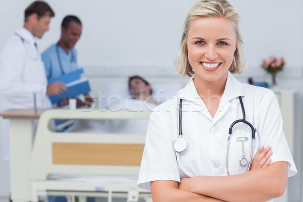 Blonde nurse crossing her arms Stock photo © wavebreak_media