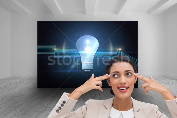 Composite image of confident young businesswoman pointing her he Stock photo © wavebreak_media