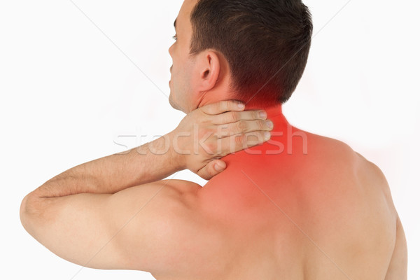 Young man experiencing neck pain Stock photo © wavebreak_media