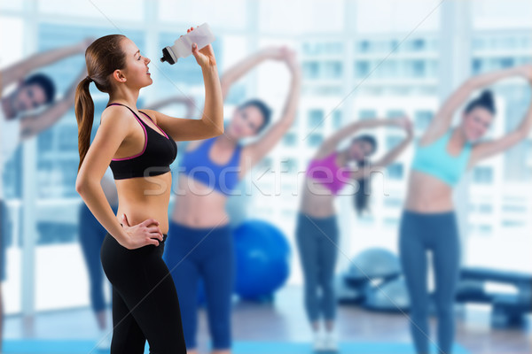 Fit brunette drinking from sports bottle Stock photo © wavebreak_media