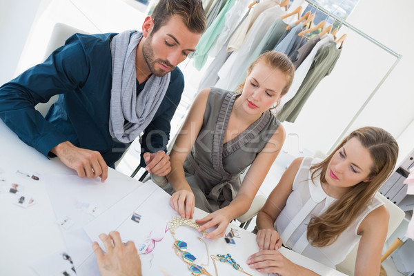 Three fashion designers discussing designs Stock photo © wavebreak_media