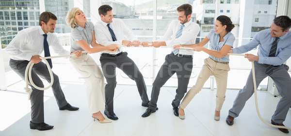 Business people playing tug of war in office Stock photo © wavebreak_media