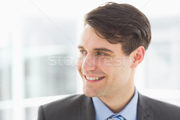 Smiling handsome businessman looking away Stock photo © wavebreak_media