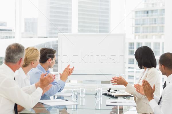 Business people applauding blank whiteboard in conference room Stock photo © wavebreak_media