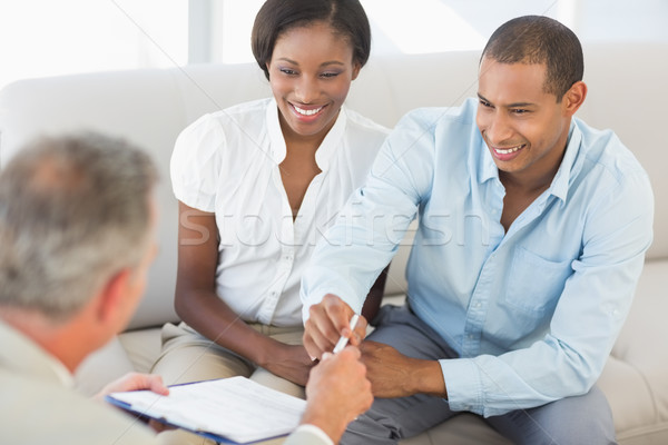 молодые улыбаясь пару прослушивании продавцом диване Сток-фото © wavebreak_media