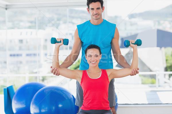 Mężczyzna trener pomoc kobieta siłowni portret Zdjęcia stock © wavebreak_media