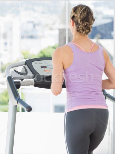 Woman exercising on treadmill Stock photo © wavebreak_media