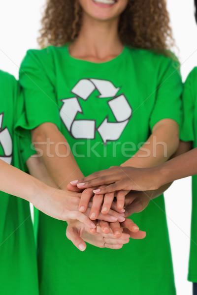 Equipo ambiental manos junto blanco feliz Foto stock © wavebreak_media