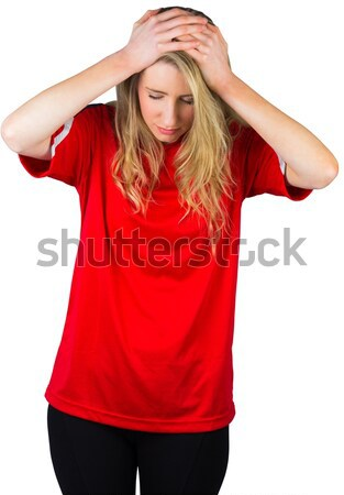 Disappointed football fan in red Stock photo © wavebreak_media