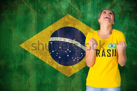 Fit girl holding brasil ball Stock photo © wavebreak_media