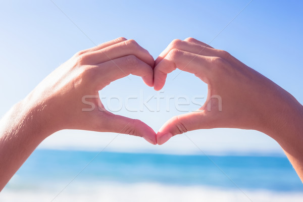 Hands making heart shape on the beach Stock photo © wavebreak_media
