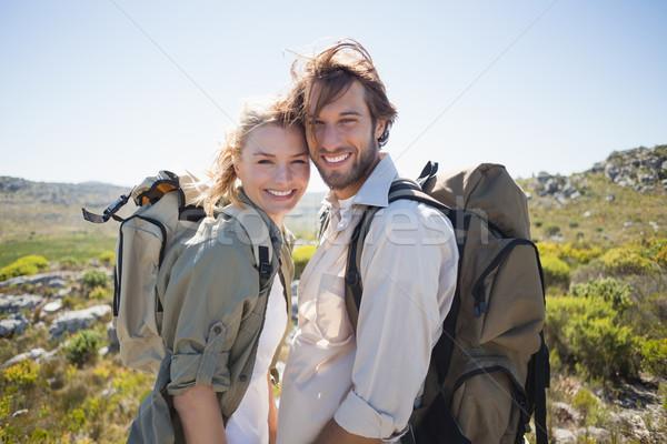 ハイキング カップル 立って 山 地形 笑みを浮かべて ストックフォト © wavebreak_media