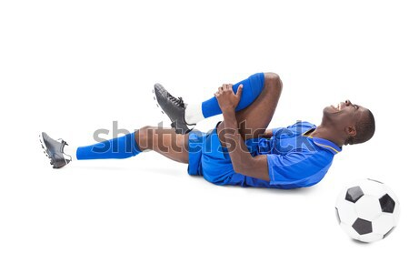 Injured football player lying on the ground Stock photo © wavebreak_media