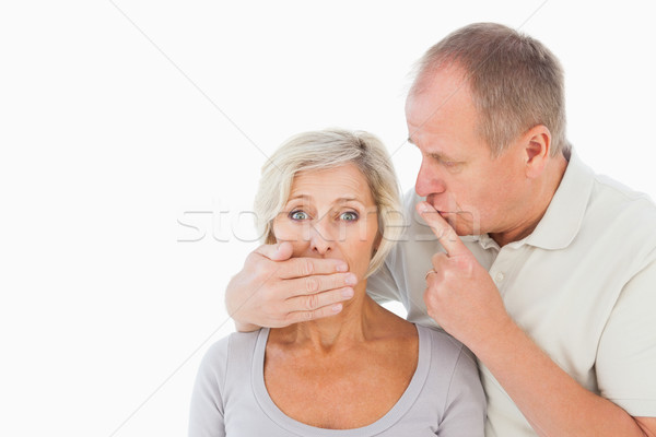 Man silencing his fearful partner Stock photo © wavebreak_media