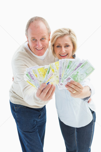 Gelukkig volwassen paar glimlachend camera tonen Stockfoto © wavebreak_media